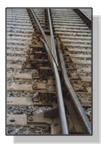 The photo illustrates a cross-over railway track.